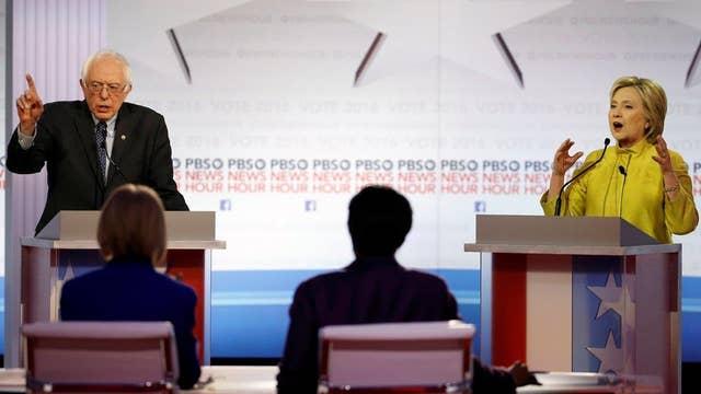 Clinton, Sanders debate health care, Wall Street reform