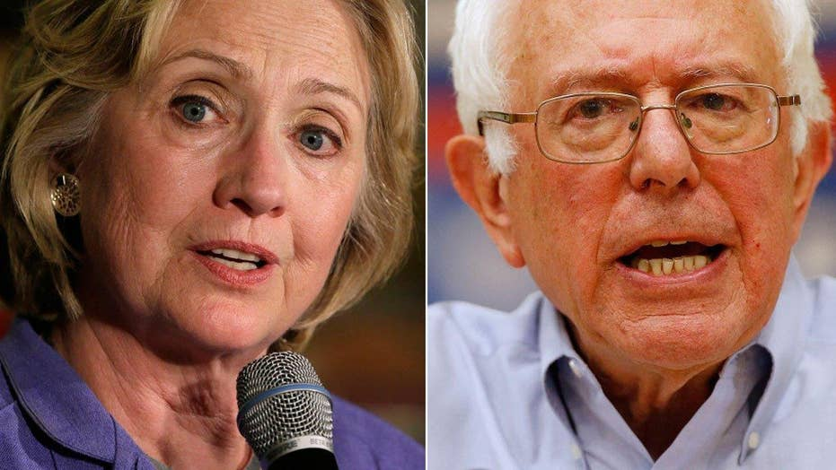 Clinton, Sanders go after each other's proposals in debate