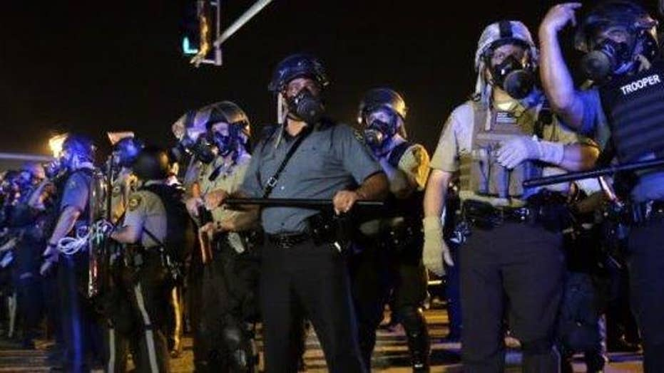 Ferguson's mayor fights back against costly police reforms