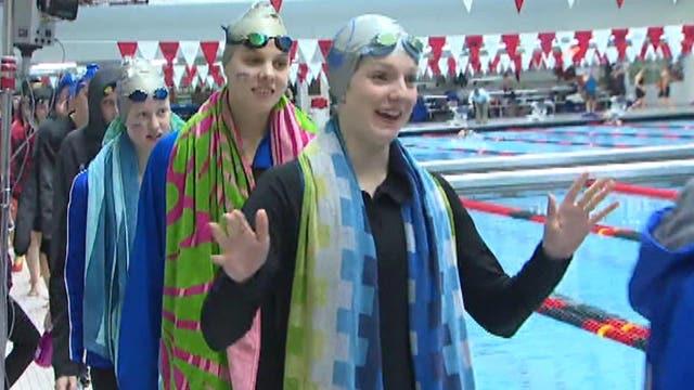 Girls swim team makes high school athletics history