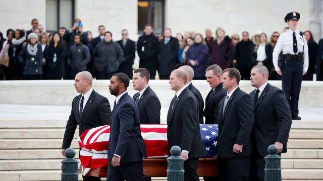 Justices gather as Scalia's casket arrives at Supreme Court