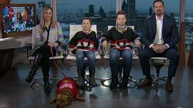 Lucky boys get a puppy after hockey player scores a goal