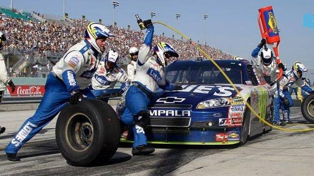 On pit road: NASCAR tire-changing race