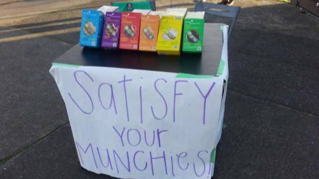 Girl Scouts sell cookies to 'satisfy munchies'