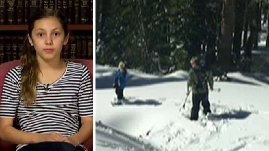 Search-and-rescue team saves girl who fell into snow hole