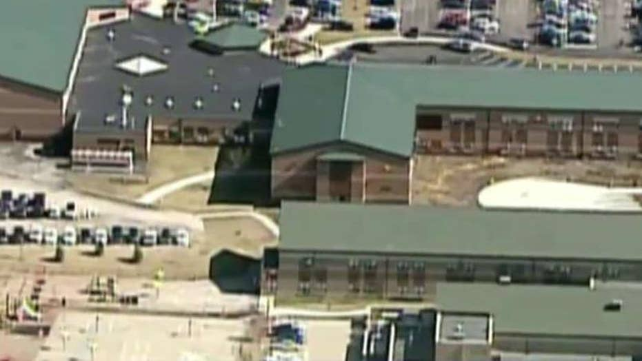 Teen charged after opening gunfire in Ohio school cafeteria