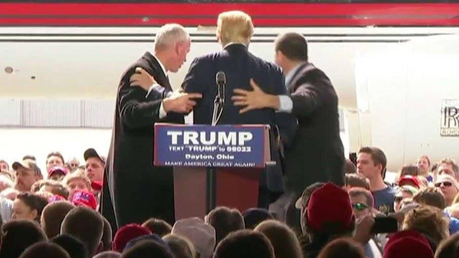 Secret Service shields Trump from protesters at Ohio rally