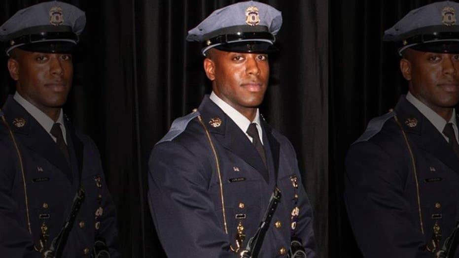 Officer gunned down outside of police headquarters