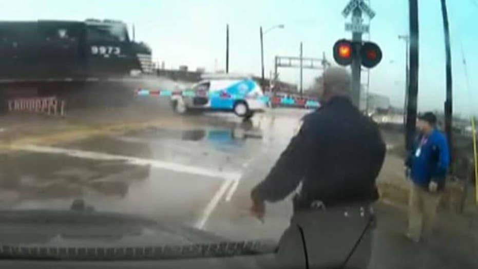 Officer saves man from oncoming train with seconds to spare