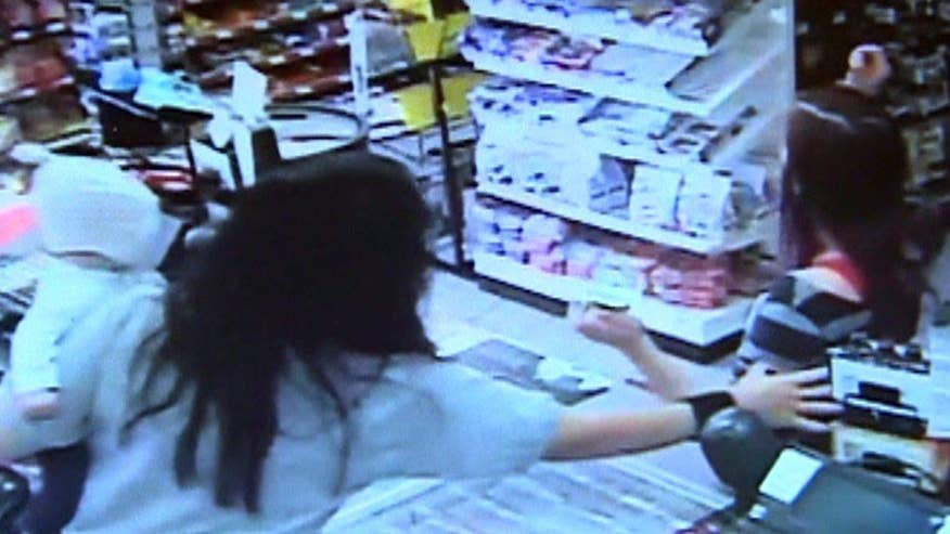 Cashier grabbed infant as woman fell