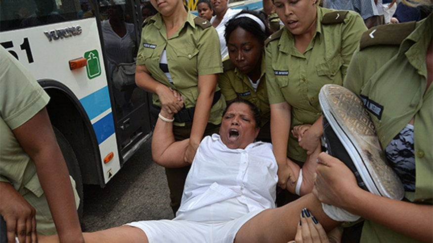 Cuban dissidents are arrested by communist government forces.