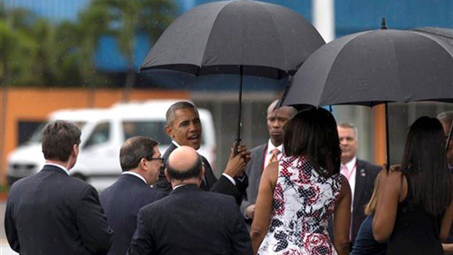 Obama and first family arrive in Cuba for historic visit