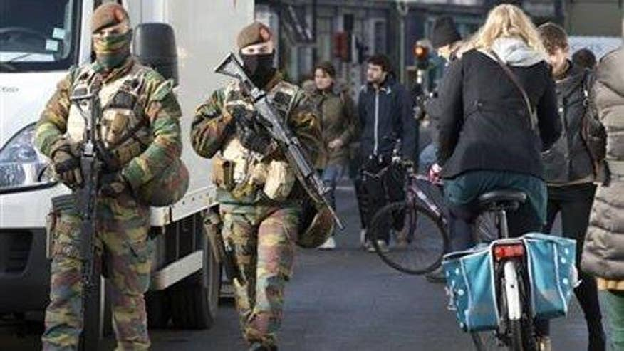 Belgian police searching for suspect in deadly terror bombings