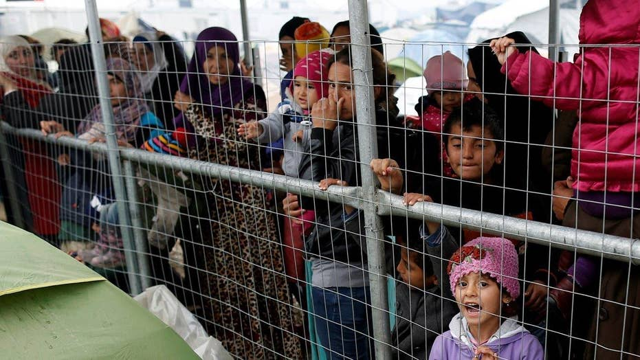 Should nations stop taking in refugees from Syria, Iraq?