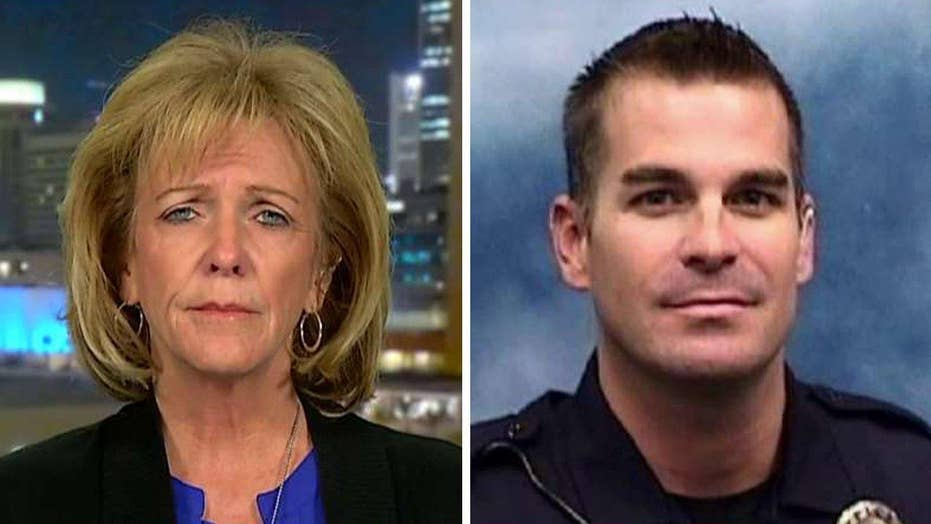 Mother of officer killed by illegal on immigration debate
