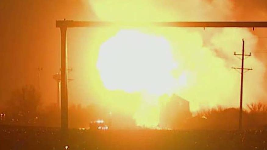 Explosion lights up the night sky, two people were taken to the hospital for minor injuries