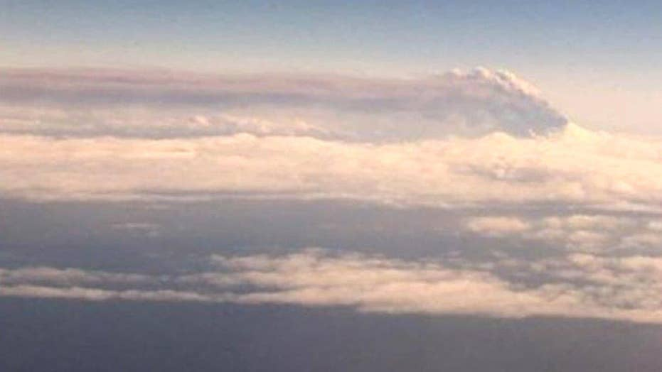 Erupting Alaskan volcano spews ash 20,000 feet into the air