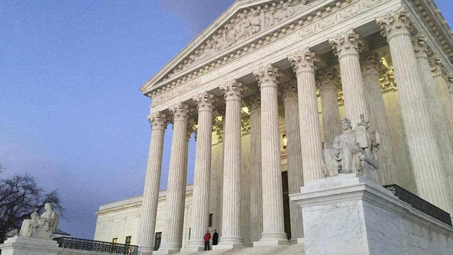 Split US Supreme Court rejects challenge to union fees