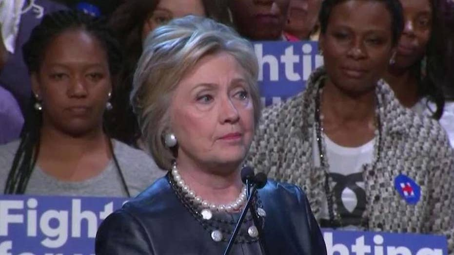Clinton fights off challenge from Sanders in New York