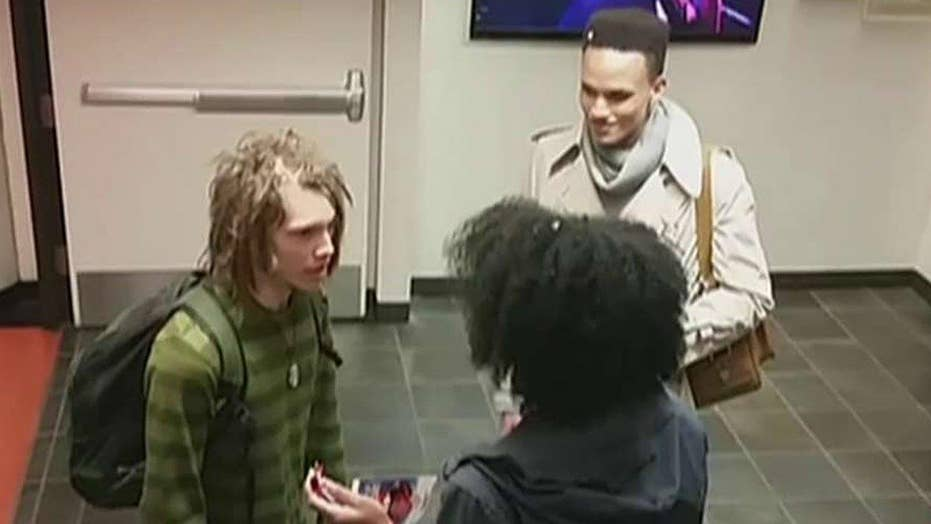 School to probe argument over white man's dreadlocks