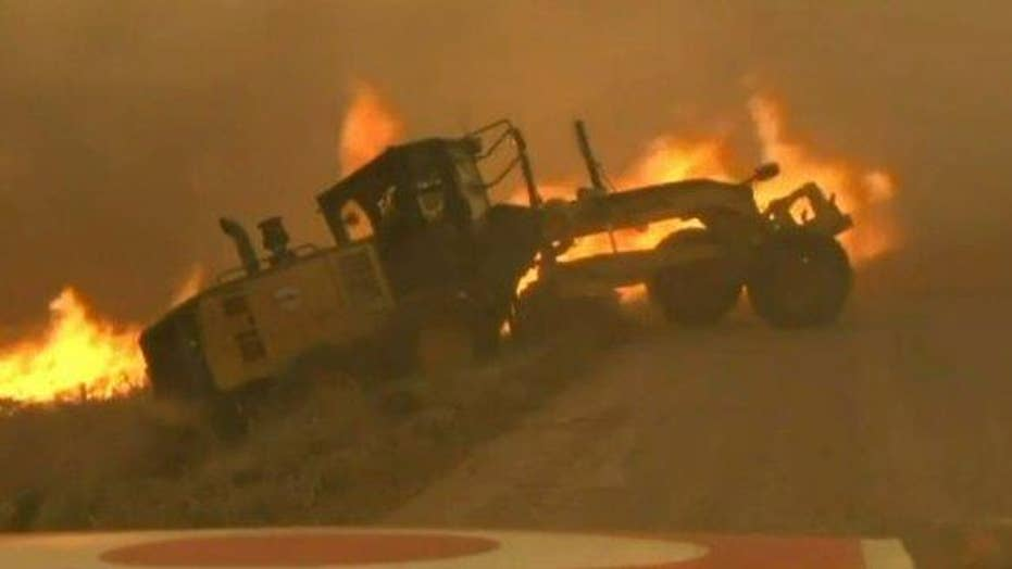 TV news crew helps driver narrowly escape from wildfire