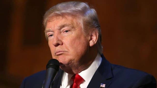 Donald Trump hires veteran political operatives
