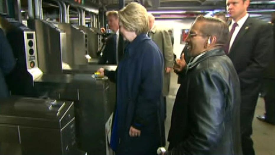 Hillary Clinton struggles with her Metrocard in NYC subway