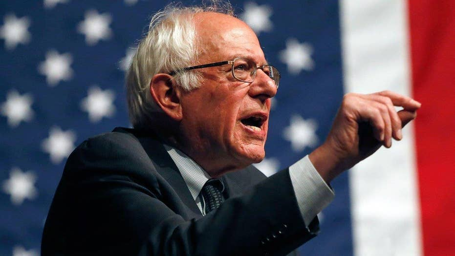 Sanders escalates spat with Clinton over qualification