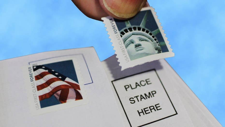USPS lowers stamp price for first time in 100 years