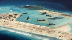 The Chinese military has deployed new fighter jets to a contested island in the South China Sea and bolstered their advanced surface-to-air missile system on the island, new satellite imagery provided exclusively to Fox News shows.