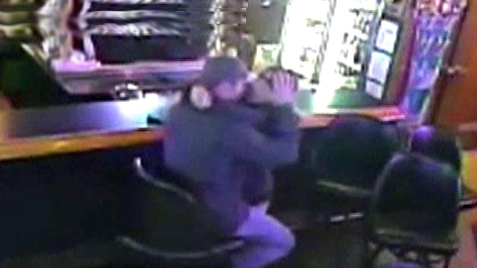Kissing couple oblivious to robbery behind them