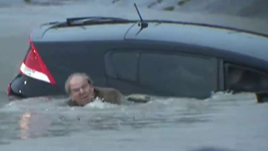 Reporter saves man from dangerous floodwaters in Texas