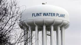 Michigan attorney general to announced charges against two state regulators, one Flint employee