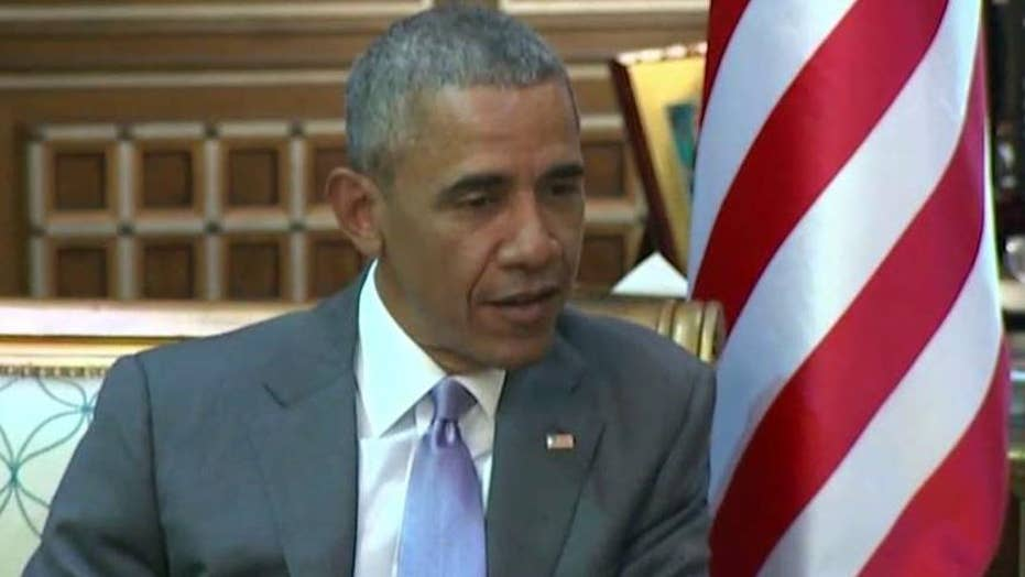 Obama finds himself wedged between 9/11 families, Saudis