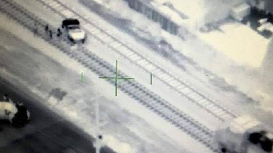 Police chopper crew stops collision between train and car