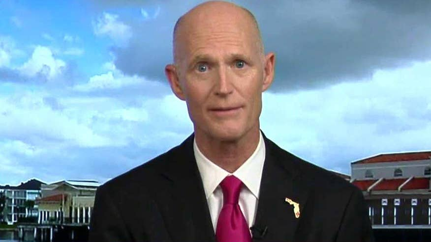 Donald Trump supporter and Florida Gov. Rick Scott says efforts to prevent Trump from clinching the Republican presidential nomination are only helping former Secretary of State Hillary Clinton