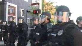 Nine people were arrested, five officers were injured