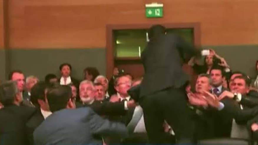 Parliament members throw punches, water