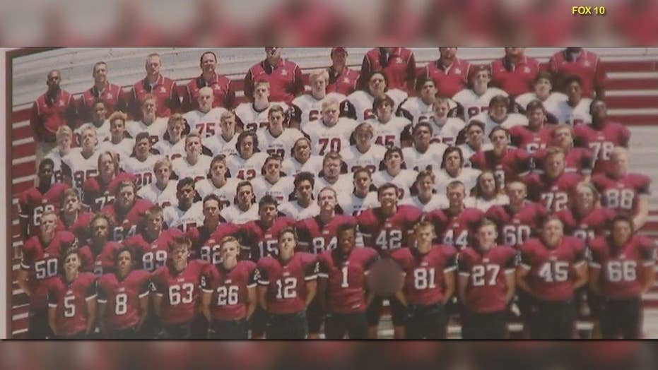 Teen arrested for flashing privates in yearbook football pic