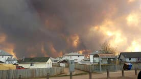 More than 80,000 residents forced to flee as flames moved into Fort McMurray in Alberta