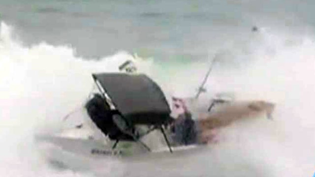 Wipeout: Surfers' boat tossed by gnarly waves