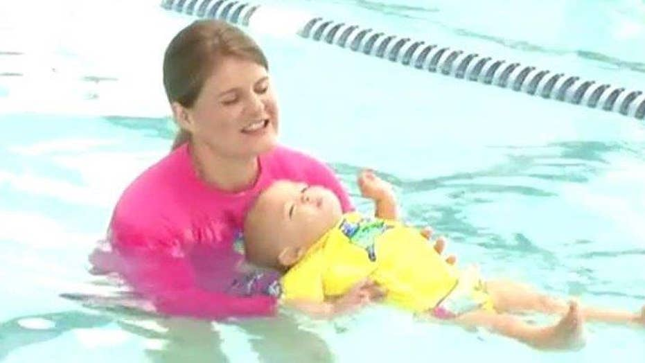 Mother defends letting her baby float in a swimming pool