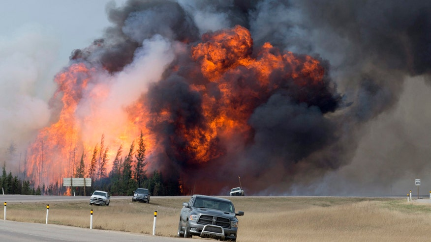 Dry conditions mean fire could spread to neighboring province
