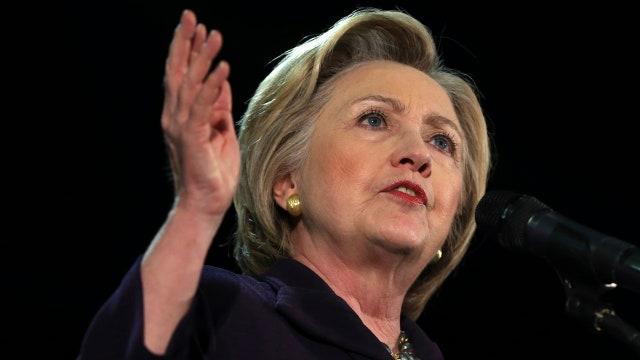 Clinton downplays FBI probe, calls it a 'security inquiry'