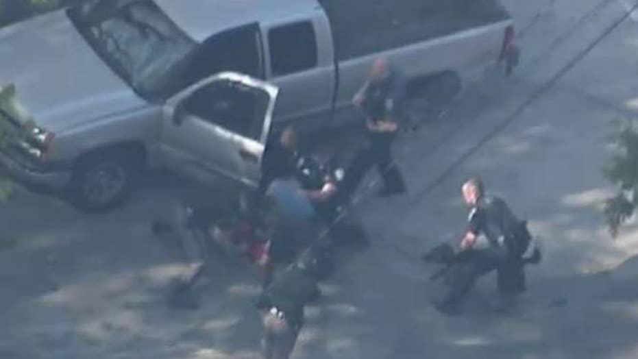 Video shows policemen beating suspect after car chase
