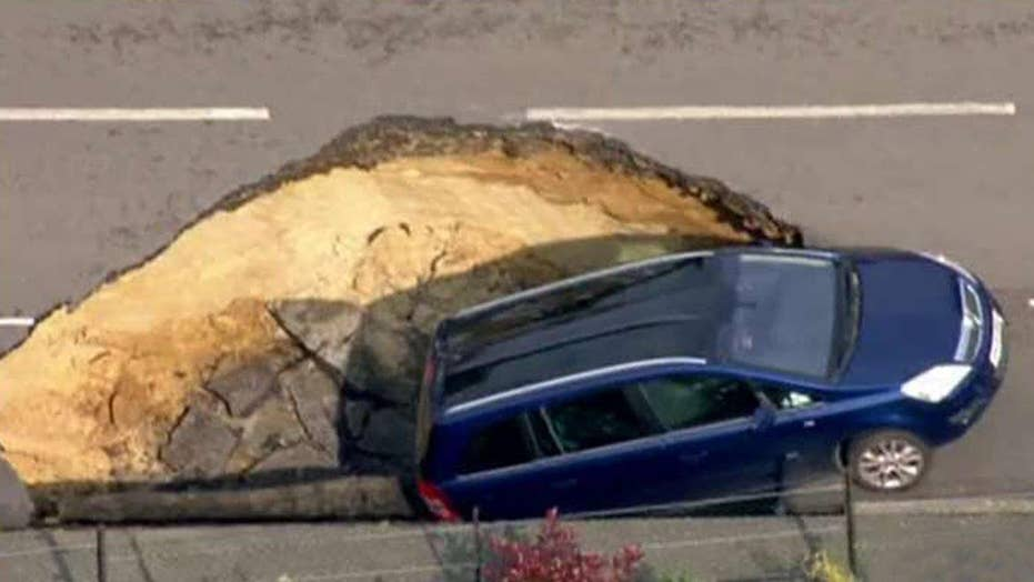 Giant sinkhole swallows car