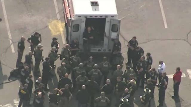 Manhunt under way for suspect in shootings of 2 NH policemen