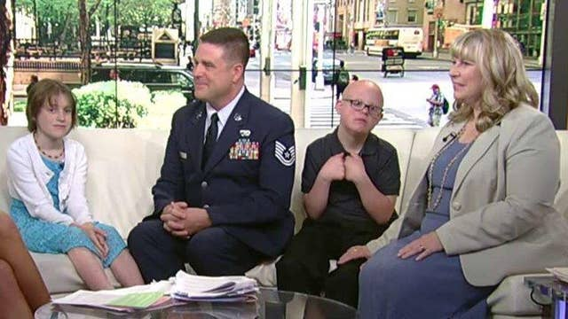 Returning soldier surprises his kids at school