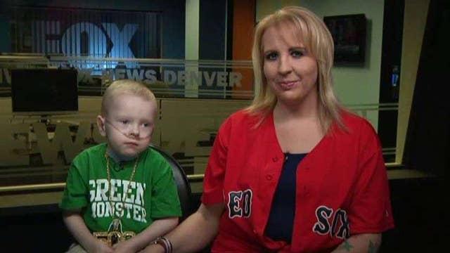 Young fan who had 30 heart procedures meets his MLB hero