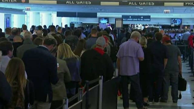 Long airport security lines leave passengers stranded